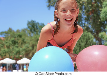 Girl with balloons - Joyful girl plays with balloons in...