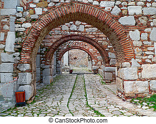 ancient arches - a series of ancient arches on an ancient...
