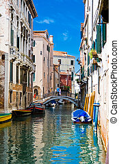 A canal in Venice - green and blue water of a typical...