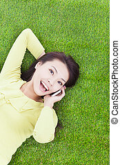 High angle view of a young woman talking with smartphone