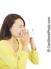 young woman using a tissue and blowing nose
