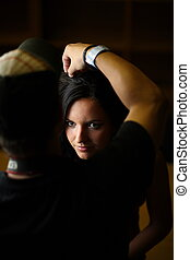 Backstage - Atractive brunette having her hair done by a...