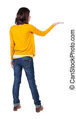 Back view of Beautiful business woman in yellow pulover...