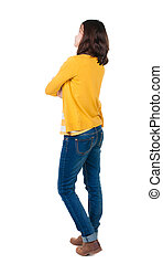 back view of standing young beautiful brunette woman in...