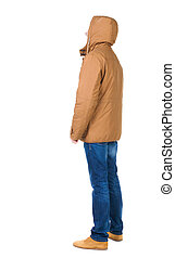 Back view of handsome man in winter jacket looking up....