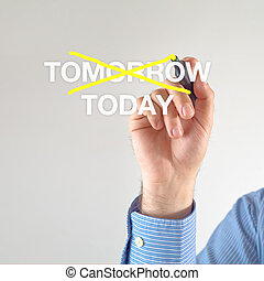 Today - Businessman crosses off tomorrow for TODAY with...