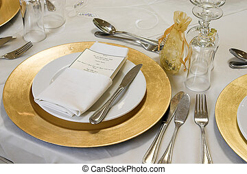 Wedding Table Setting - Wedding Table setting with golden...