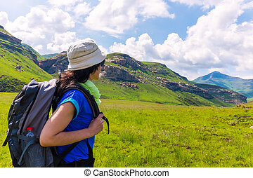 Female tourist hiking in mountains - Young female tourist...