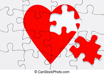 Broken heart jigsaw - A red heart jigsaw puzzle with a piece...