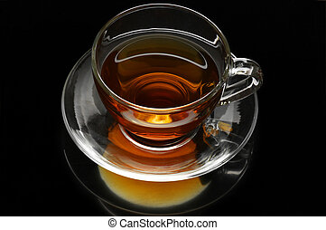 Tea cup - Glass cup of tea on black background