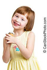 happy child girl eating ice cream in studio isolated