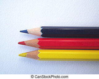 Row of blue red and yellow pencils - Three coloured pencils,...