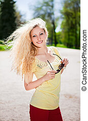 Cheerful blonde with sunglasses