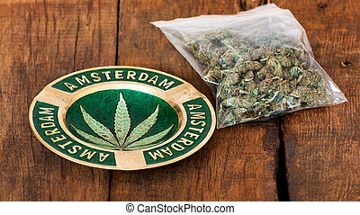 Marijuana - Ashtray with amsterdam sign and a big plastic...