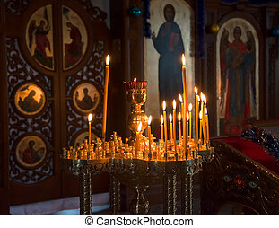 Candles in the Orthodox Church - Candles in front of icons...