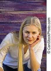 Young blonde woman with serious expression