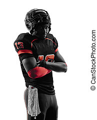 american football player standing arms crossed silhouette -...