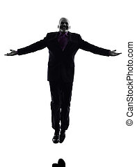 senior business man jumping arms outstretched silhouette