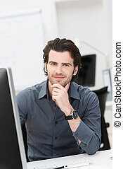Friendly businessman at his desk - Friendly attractive young...