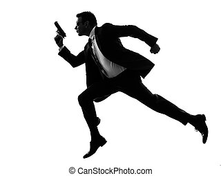 man with handgun running silhouette - one caucasian man...