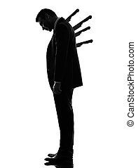 business man Stabbed in the Back silhouette - one caucasian...