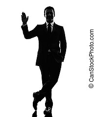 business man saluting silhouette - one caucasian business...