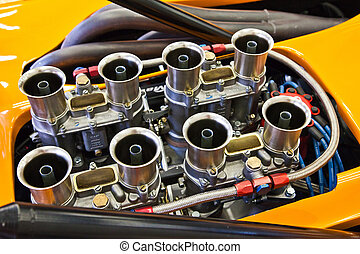 Old race car engine orange with big pipes