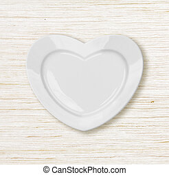heart shape plate on wodden table top view