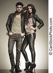 in love couple dressed in leather clothes in a fashion pose...