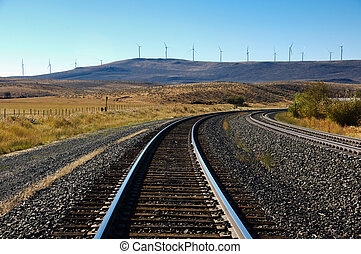 Wind turbines and railroad tracks - Wind turbines in the...