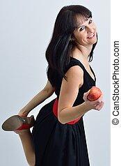 Frau mit einem Apfel in der Hand - Junge Frau mit einem...