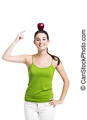 Healthy woman pointing to a apple