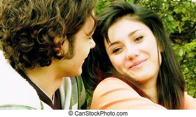 Shy girl looking in love boyfriend - Happy young woman in...