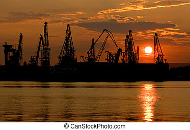Industry harbor - Sunset over an industry harbor with cranes...