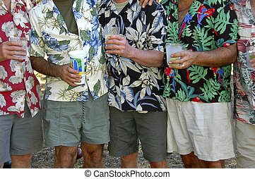 Men in tropical shirts with drinks - Men in tropical print...