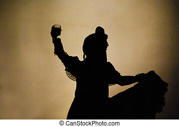 Raise your glasses high - Silhouette of female Mexican folk...