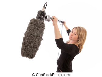Female Boom Operator - Woman holding up a microphone boom...