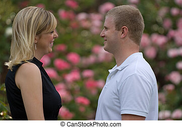 Couple in a garden - Couple gazing at each other...