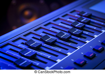 MIDI Faders on a Controller Keyboard - Close-up of a row of...