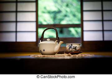Japanese Tea Ceremony - Teapot and tea bowl on a table in a...