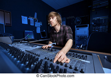 Man using a Sound Mixing Desk - Man using a sound mixing...