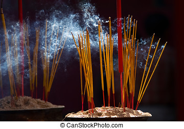 Burning incense sticks - Burning incense stick in a chinese...