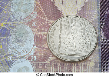 Ten pence over note in close up