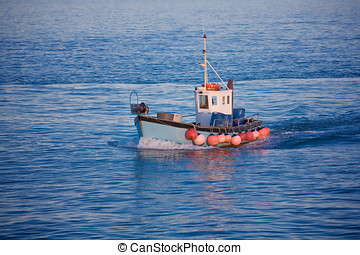 fishing trawler at sea - Fishing trawler arrives at a...