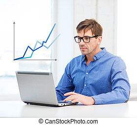 man working with laptop at home - technology, economy,...