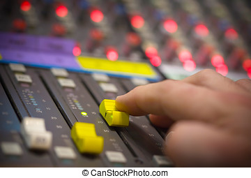 Sound mixing - Hand pushing open a fader on a sound desk...