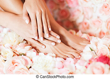female legs and hand - beauty and healthcare - closeup of...