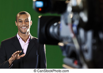 Presenter in TV Studio with foreground camera - Television...