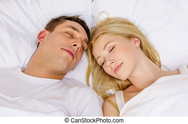 happy couple sleeping in bed - hotel, travel, relationships,...