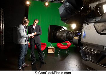 TV Studio preparations - Floor manager and presenter chat in...
